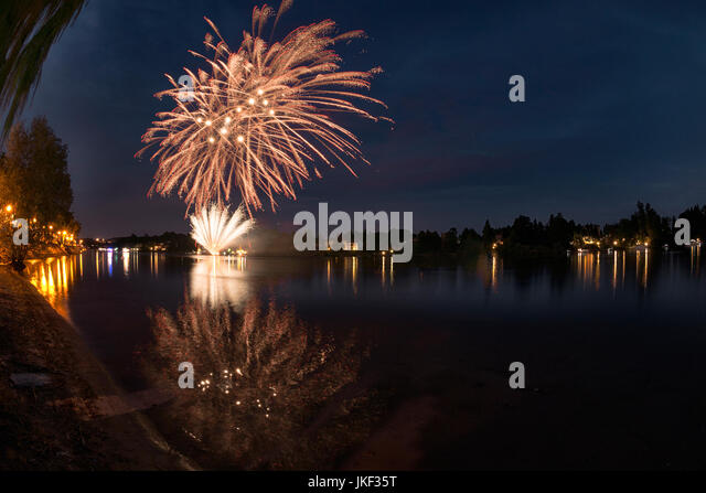 Fireworks on the river Ticino in a summer evening with landscape in the background - Stock Image