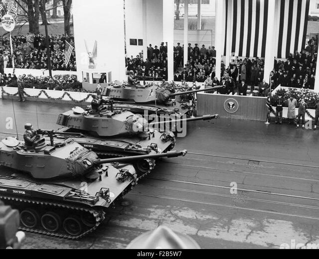 U.S. Army tanks pass Eisenhower's reviewing stand during the Inaugural parade. Jan 21, 1957. - (BSLOC_2014_16 - Stock Image