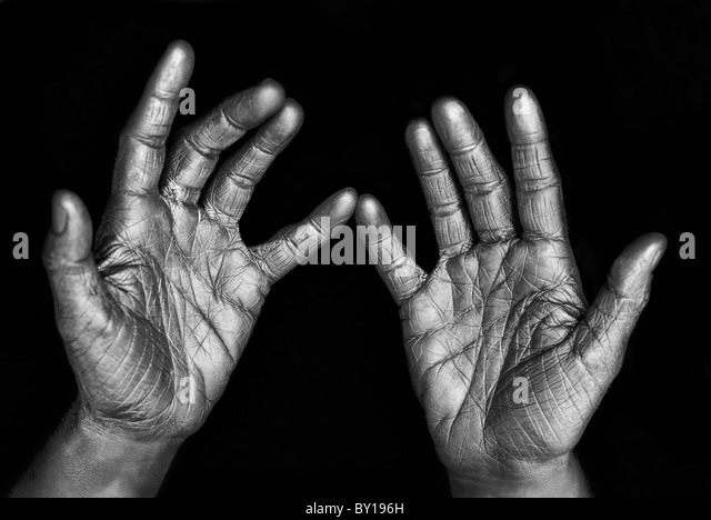 Close-up of woman's silver wrinkled hands, studio shot - Stock Image