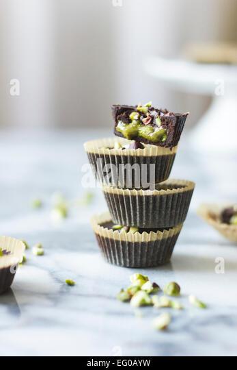 Pistachio chocolate cups - Stock Image