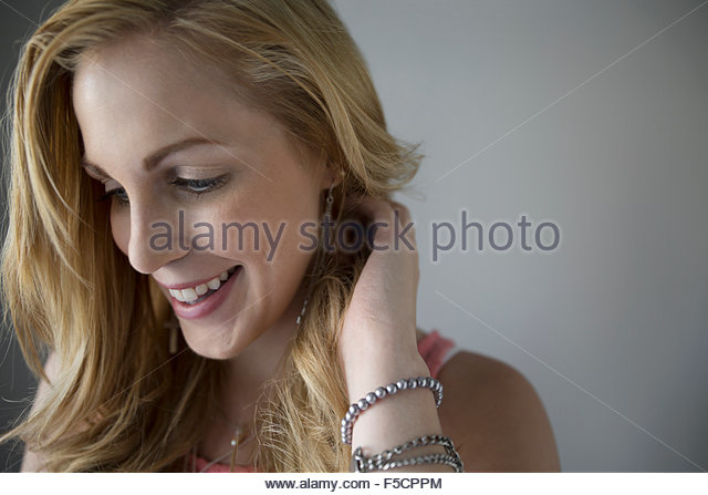 Close up smiling woman looking down - Stock Image