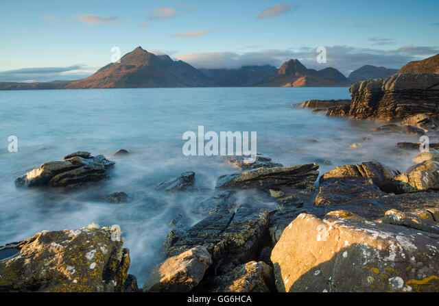 Looking northwest towards the Cuillin Hills from Elgol beach at dusk, Isle of Skye, Scotland - Stock Image