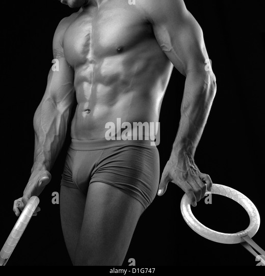Body Builder with rings - Stock Image