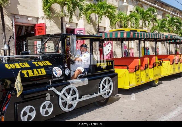 Florida Key West Mallory Square Conch Tour Train touring man driver - Stock Image