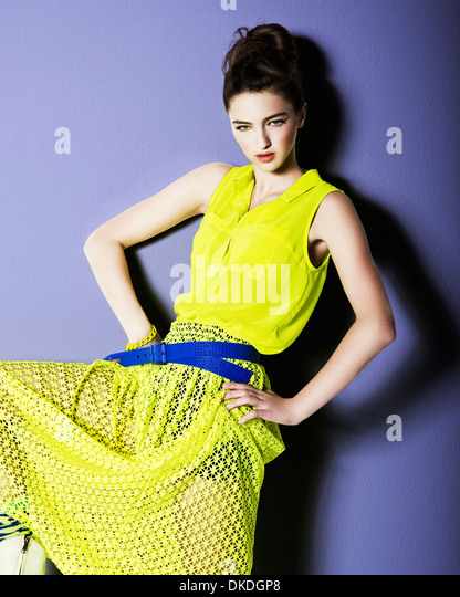 young teenager posing in a yellow dress - Stock-Bilder