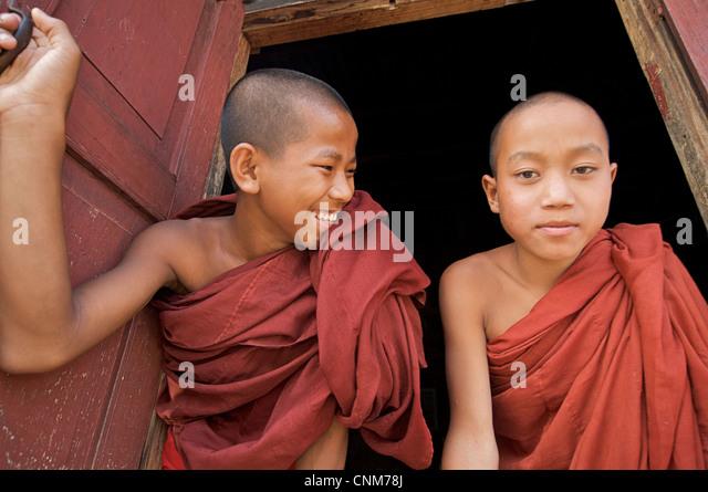 Buddhist monks at window of quarters, Kalaw Monastery, Burma - Stock-Bilder