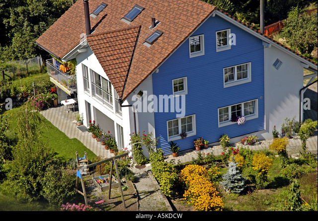 aerial above Lake Lucerne luzern Switzerland traditional swiss chalet - Stock Image