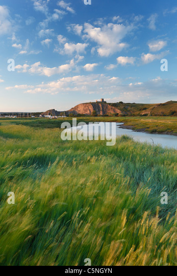 River Axe at Uphill with the Old Church on the Hilltop. Somerset. England. UK. - Stock-Bilder