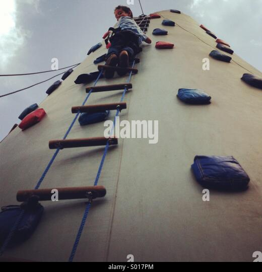 Climb your way up with confidence - child climbing  up the ladder - Stock-Bilder