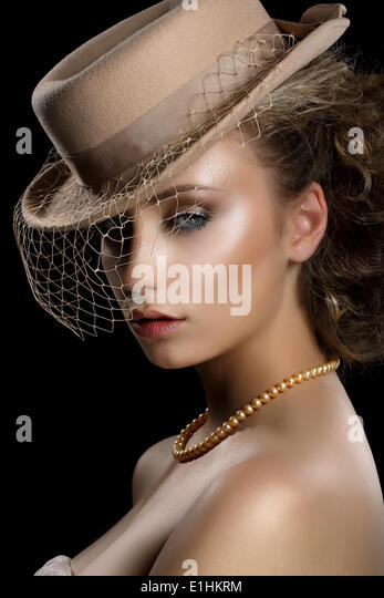 Charm. Retro Styled Romantic Woman in Vintage Brown Hat and Veil. Nostalgia - Stock Image