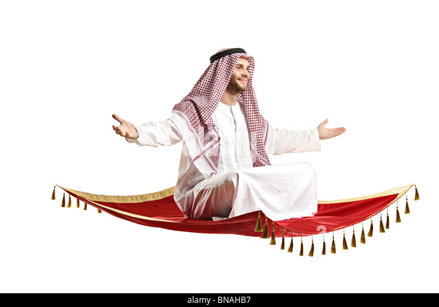 An Arab person sitting on a flying carpet - Stock Image
