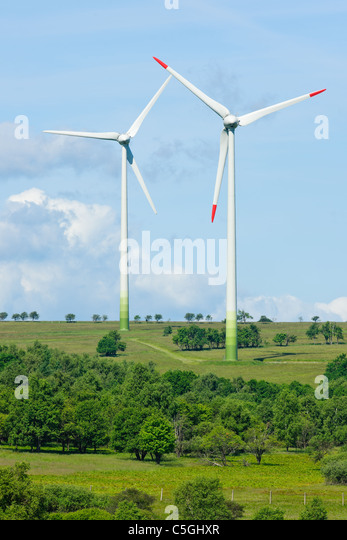 Green energy windmill generators ecology countryside blue sky - Stock Image