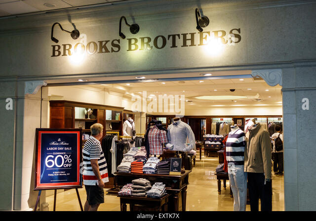 Dallas Texas Dallas Ft. Fort Worth International Airport DFW American Airlines terminal concourse Brooks Brothers - Stock Image