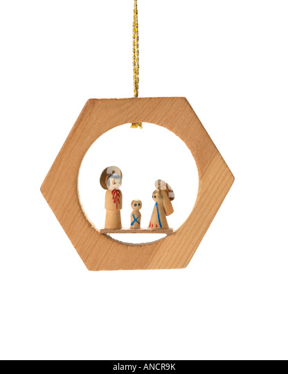 Christmas ornament nativity creche hanging on string - Stock Image
