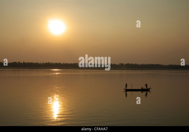 Fishermen out setting nets as the sun sets over the Mekong River, Kratie, Cambodia. - Stock Image