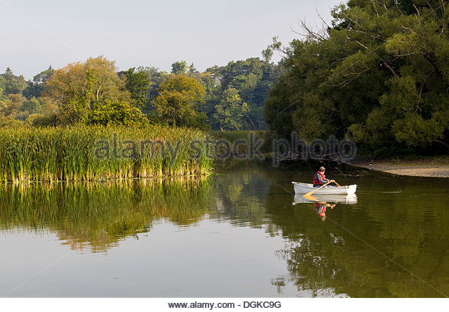 Rowboat on Rouge River in Rouge National Urban Park an urban wilderness inside Toronto Ontario Canada - Stock Image