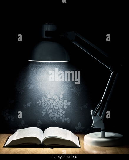 Lamp that illuminates an open book - Stock Image