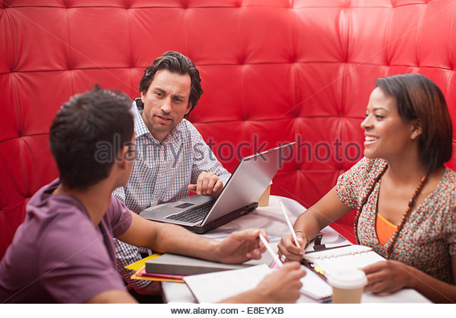 Smiling business people in meeting - Stock Image