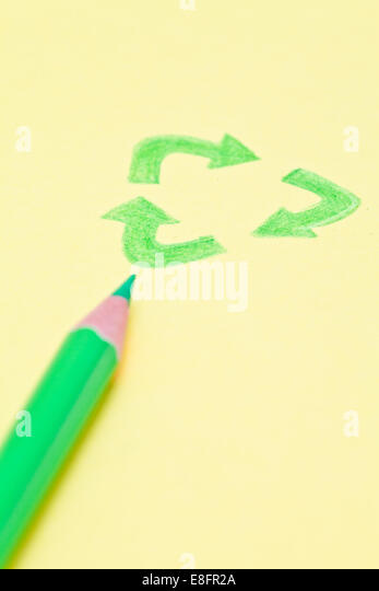 Pencil with drawing of recycling sign - Stock Image