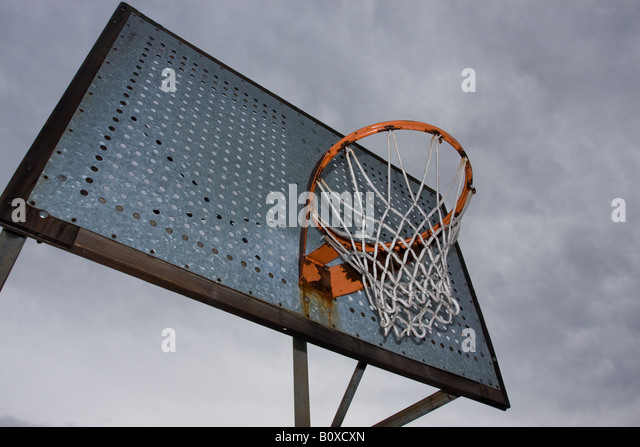 Outdoor Basketball hoop on an Urban outdoor playground. - Stock Image