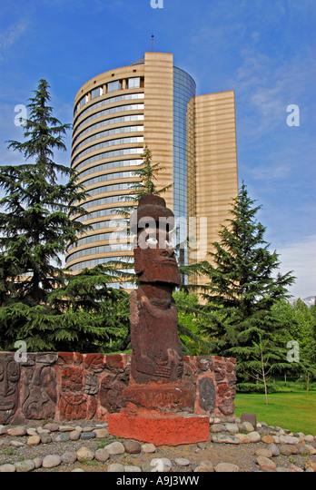 Santiago Chile Hyatt Regency Hotel trees easter island statue - Stock Image
