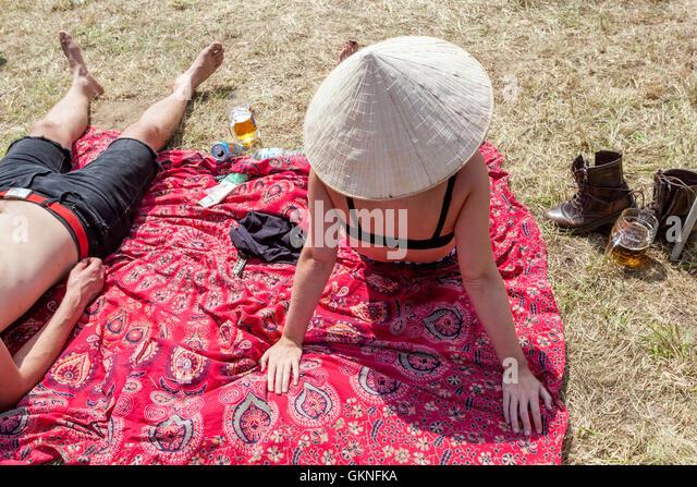 Summer couple sunbathing on a blanket, summer mood, Czech Republic - Stock Image