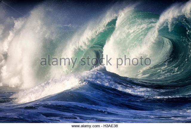 huge shorebreak in Waimea Bay - Stock Image