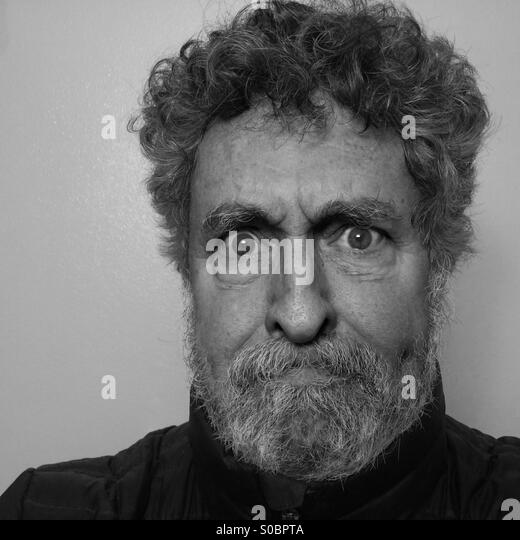 White man, age 64, with beard and expression of anger and frustration , close-up, Seattle, USA - Stock-Bilder