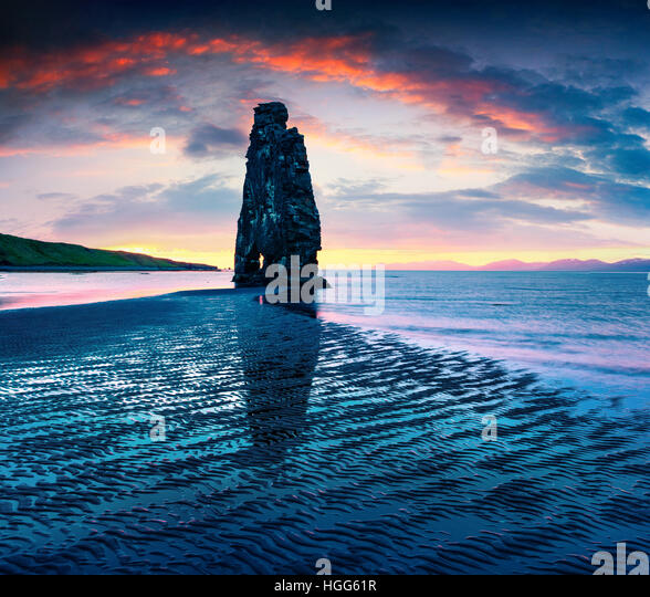 Huge basalt stack Hvitserkur on the eastern shore of the Vatnsnes peninsula. Colorful summer sunrise in northwest - Stock Image