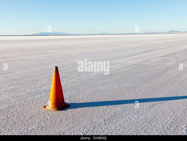 A single traffic cone in the white landscape of the Bonneville Salt Flats, during Speed Week - Stock Image