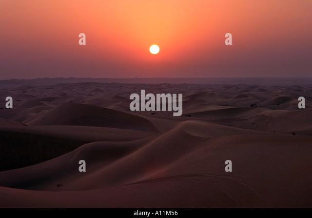 Sunset over the desert, Abu Dhabi,  UAE - Stock Image