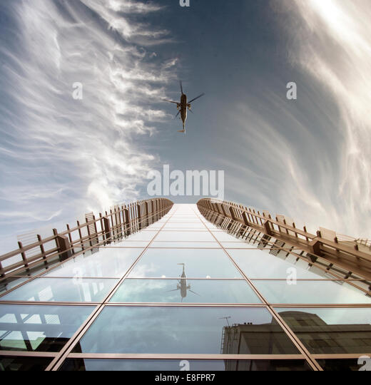 Helicopter reflection in modern building - Stock Image