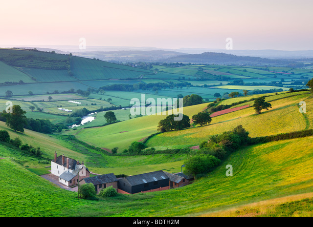 Farm nestled in the Exe valley overlooking the River Exe, Devon, England. Summer (June) 2009 - Stock Image