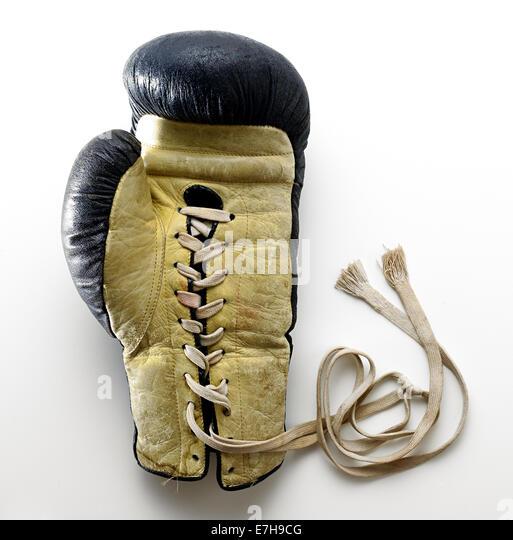 Boxing Glove Lying on White Background - Stock Image