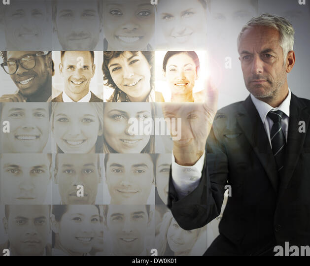 Stern businessman choosing future employees - Stock Image