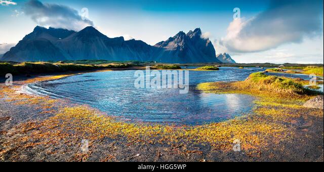 Colorful panorama of the Stokksnes headland on southeastern Icelandic coast. Iceland, Europe. - Stock Image