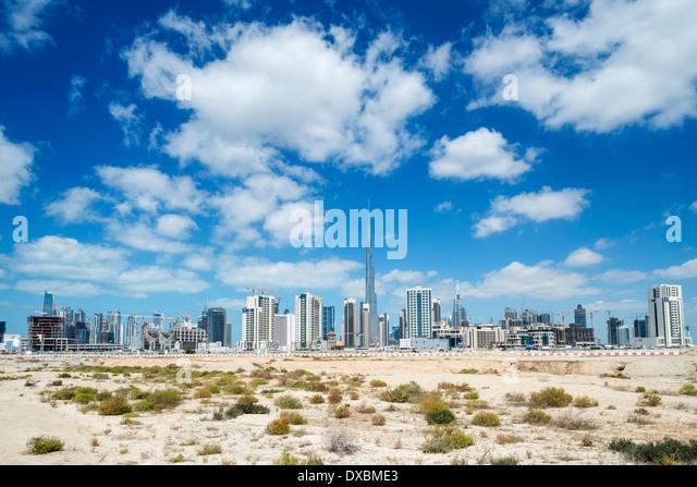Skyline of Dubai from the desert in United Arab Emirates - Stock Image