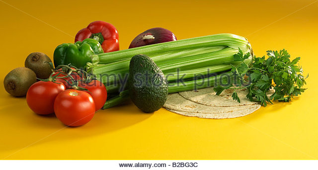 Assorted fruit and vegetables on tortillas - Stock Image