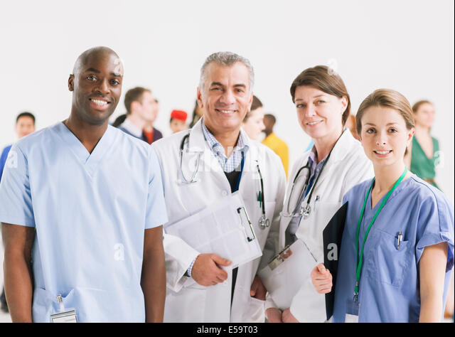 Portrait of smiling doctors and nurses - Stock Image