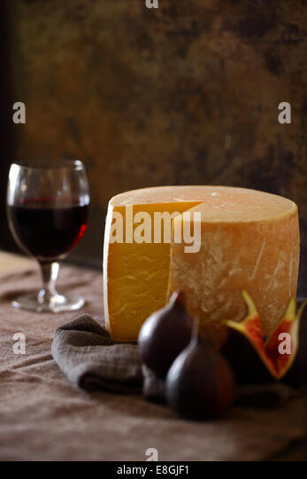 Cheese, figs and red wine - Stock Image