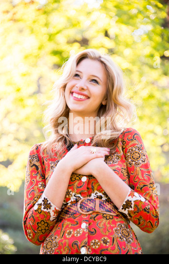 Smiling Woman Outdoors - Stock Image