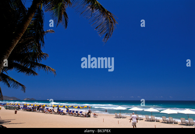 Isla Margarita island Venezuela Playa El Aqua beach chairs ocean scenic landscape - Stock Image