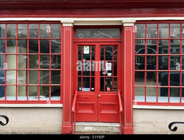 Red painted Georgian style shopfront, Ironbridge, Shropshire, England. - Stock Image
