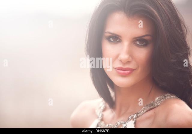 Beauty fashion portrait of woman outside in field - Stock-Bilder