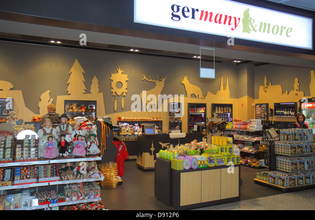 Germany Frankfurt am Main Airport FRA terminal gate area concourse shopping retail display for sale front entrance - Stock Image