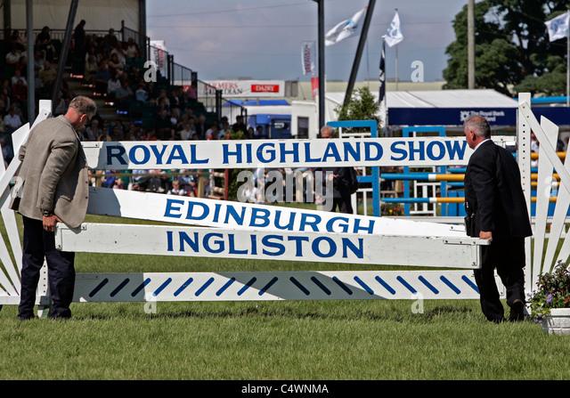 Stewards rebuild a jump during the show jumping competition at the Royal Highland Show, Ingliston, Edinburgh - Stock Image