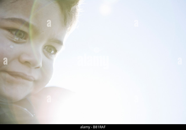Young boy in sunlight - Stock Image