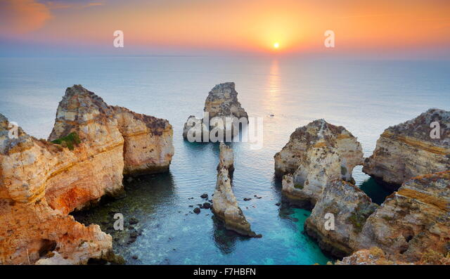Sunrise landscape at Algarve coast near Lagos, Portugal - Stock Image