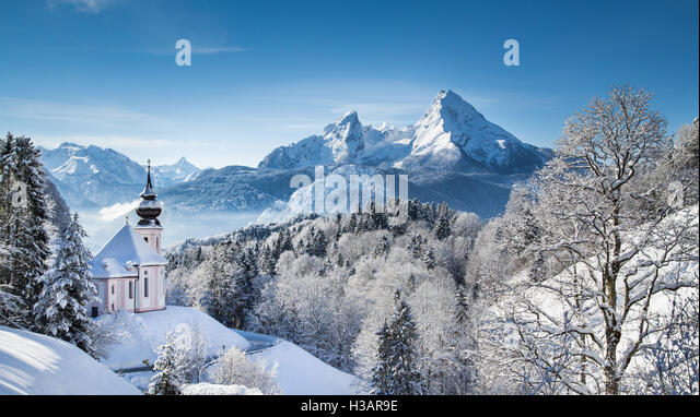 Idyllic winter wonderland in the Alps with pilgrimage church of Maria Gern and famous Watzmann mountain summit, - Stock Image