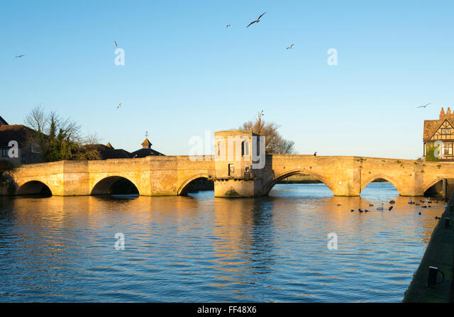 The old bridge over the River Great Ouse at St Ives Cambridgeshire UK with the 13th century chapel built into it. - Stock Image